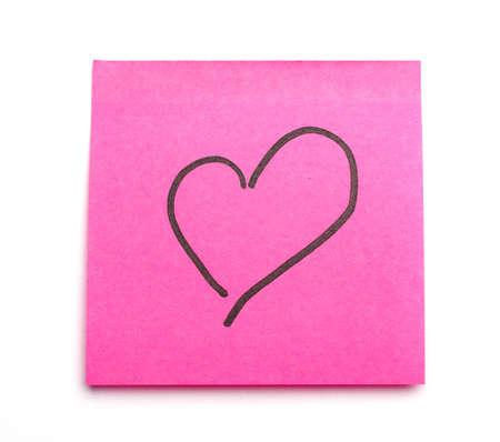 적합: Post it note with heart symbol as concept for office romance. Suitable for St Valentines Day