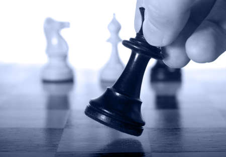 Chess piece on a chessboard being moved as a business concept Stock Photo - 4495540