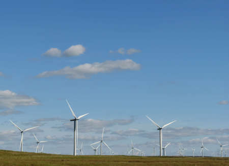 Line of wind turbines on a Scottish wind farm in Europe