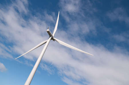 Wind turbine on a wind farm in Scotland, Europe. Dynamic angle against summer clouds. Stock Photo - 7710987