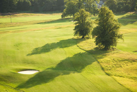 Long shadows in evening on golf course in Scotland photo