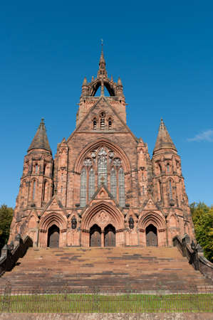 funded: Thomas Coats Memorial Church in Paisley, Scotland. This red sandstone church was funded by a textile industrialist whose mills dominated the town. Generations of stonemasons served their apprenticeships on its construction. Stock Photo