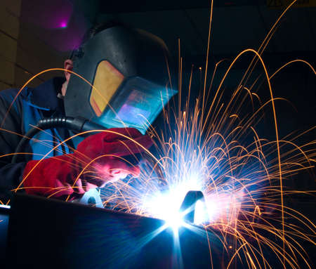 Close up of arc welding in manufacturing plant photo