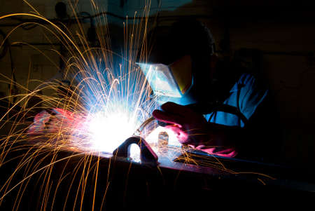 ironwork: Arc welding in manufacturing plant Stock Photo