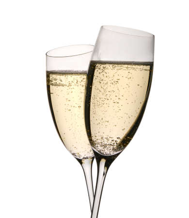 Sparkling wine in two glasses clinked in toast to celebrate event. Isolated on white.