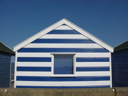 southwold: Blue and white beach hut on sunny day in Southwold, Suffolk, England, UK