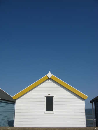 southwold: Yellow and white beach hut on sunny day in Southwold, Suffolk, England, UK Stock Photo