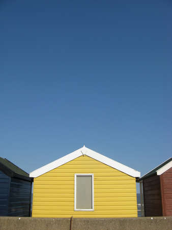 southwold: Yellow beach hut on sunny day in Southwold, Suffolk, England, UK