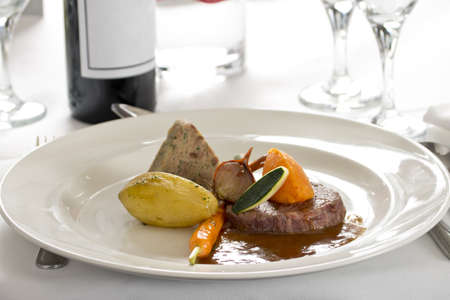 differential focus: Steak and vegetable dish on table in gourmet restaurant with differential focus Stock Photo