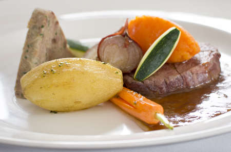 differential focus: Gourmet steak meal in restaurant close-up with differential focus