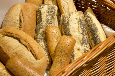 Different kinds of bread in a wicker basket photo