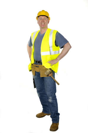 white color worker: Construction worker on white background stands with hands on hips smiling confidently