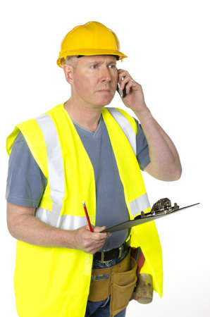Construction worker with clipboard on white background takes call Stock Photo