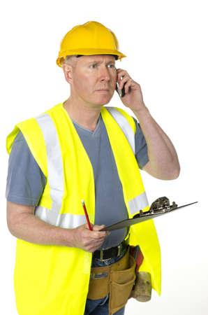 Trabajador de la construcci�n con portapapeles sobre fondo blanco se llama Foto de archivo