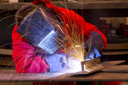 Welder in workshop manufacturing metal construction Stock Photo
