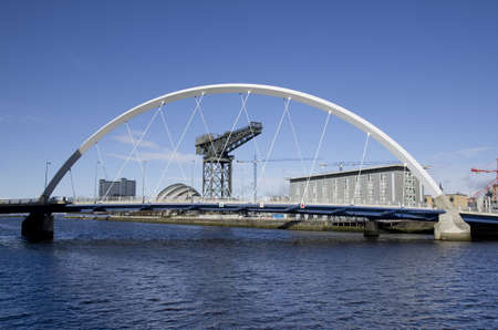 River Clyde in Glasgow with bridge, crane and modern buildings