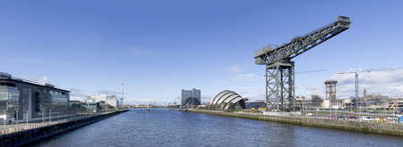 High resolution panorama of the River Clyde in Glasgow showing Finnieston Crane, Armadillo, Bell Standard-Bild