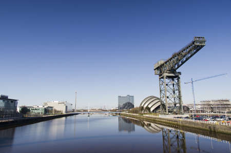 glasgow: River Clyde in Glasgow with bridge, crane, auditorium and modern buildings