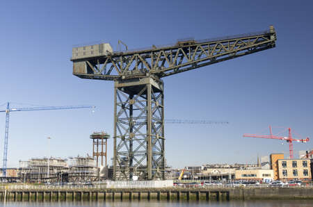Modern and traditional cranes on the landmark quayside of River Clyde in Glasgow, Scotland