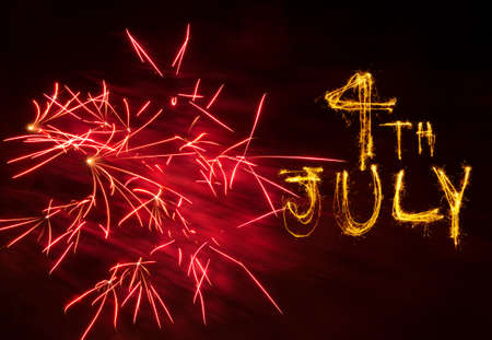 Pink explosion of fireworks and sparkler writing of 4th July