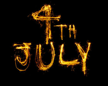 4th July written in sparklers isolated on black