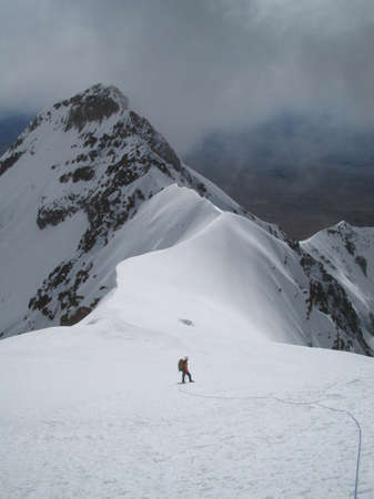 Mountaineer on Nevado Solimana, an alpine peak in Peru