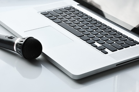 commentator: Microphone near laptop. Devices for singer, commentator or other people.