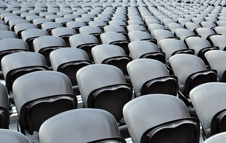 A rows black seats on the stadion. The Donbass Arena (Donetsk, Ukraine) is the first stadium in Eastern Europe designed and built to UEFA elite standards. Arena for semifinals Euro-2012. Stock Photo - 10173973
