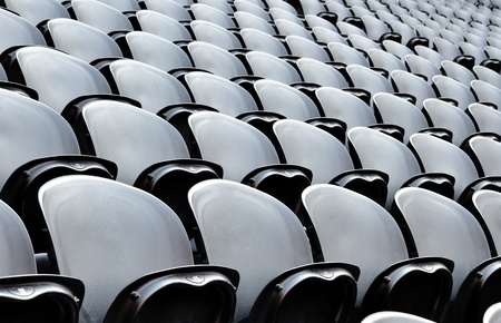 donbass: a rows black seats on the stadion. the donbass arena (donetsk, ukraine) is the first stadium in eastern europe designed and built to uefa elite standards. arena for semifinals euro-2012. Stock Photo