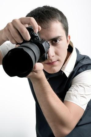 photographic camera: Paparazzi with digital camera. Classic shoot.