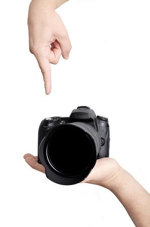 デジタル カメラで写真を撮る。指は、シャッターを押した。