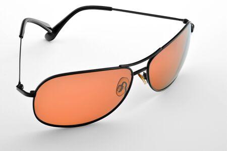 白い背景上に分離されて昔ながらのオレンジのサングラス 写真素材
