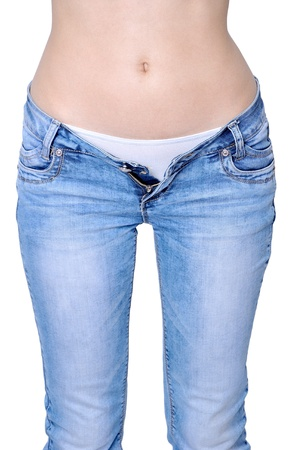 Selective focus on stomach of young woman. Unusual navel. Image isolated on white background. Stock Photo