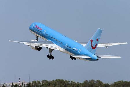 britannia: Luqa, Malta - August 10, 2004: Britannia Airways Boeing 757-204 takes off from runway 32. This aircraft is now in Thomson Airways colours.
