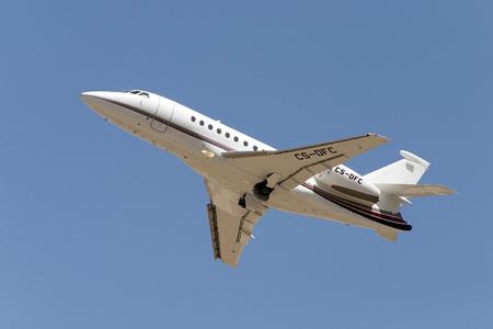 cs: Luqa, Malta - August 10, 2004: NetJets Dassault Falcon 2000 [CS-DFV] on the climb out from runway 32.
