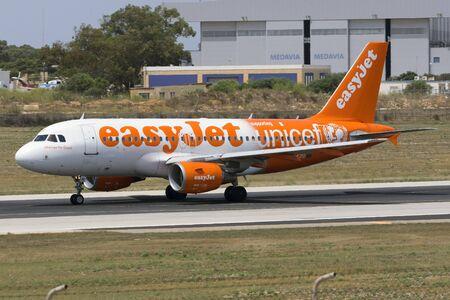 unicef: Luqa, Malta - July 2, 2016: EasyJet Airline Airbus A319-111 [G-EZIO] in special Unicef Color scheme departing runway 13. Editoriali