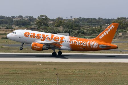 unicef: Luqa, Malta - July 2, 2016: EasyJet Airline Airbus A319-111 [G-EZIO] in special Unicef Color scheme departing runway 13. Editoriali