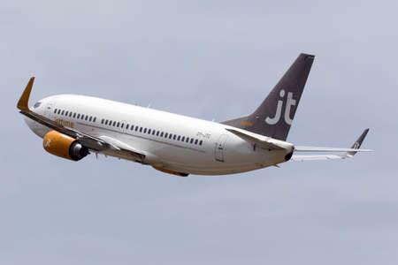 departing: Luqa, Malta - July 2, 2016: Jet Time Boeing 737-3L9 [OY-JTC] departing runway 13.