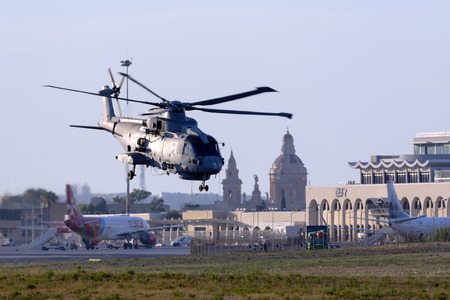 mago merlin: Luqa, Malta 20  July 2016: Royal Navy Agusta-Westland Merlin HM.1 [ZH843] departing runway 13 after a fuel stop.