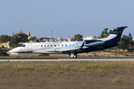 lining up: Luqa, Malta - 20  July 2016: Avcon Jet Embraer ERJ-135BJ Legacy 650 [OE-IML] lining up runway 31 for departure. Editorial
