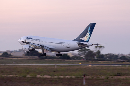 sata: Luqa, Malta - 27  July 2016: SATA International Airbus A310-304 [CS-TGV] operating flight EVJ916 from Lisbon, after a 2 hour delay.