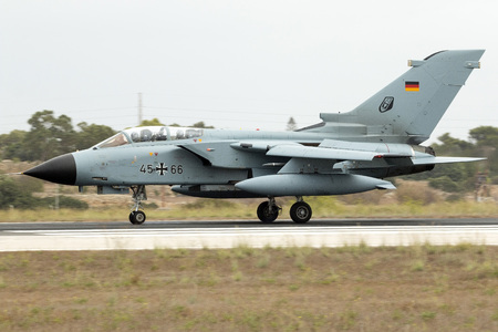 supersonic transport: Luqa, Malta - 25  September 2014: German Air Force Panavia Tornado IDS landing runway 31 to participate in the airshow the weekend after.