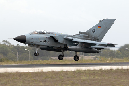 supersonic transport: Luqa, Malta - 25  September 2014: German Air Force Panavia Tornado IDS [4566] landing runway 31 to participate in the airshow the weekend after.