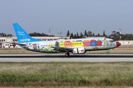 unicef: Luqa, Malta - 19 April 2008: Norwegian Air Shuttle Boeing 737-33A [LN-KKS] in special UNICEF color scheme landing runway 13.