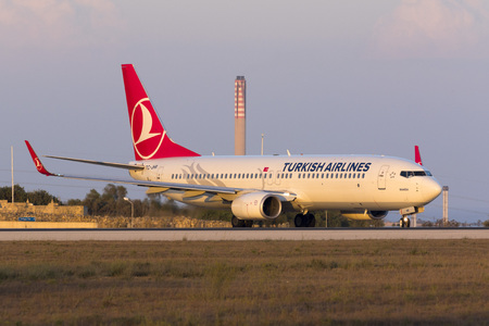 lining up: Luqa, Malta - 12 August 2016: Turkish Airlines Boeing 737-8F2 [TC-JHR] lining up for take off just as the sun sets down.