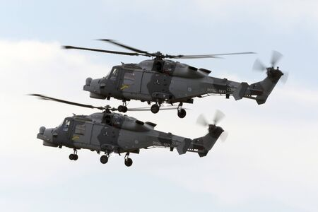 westland: Luqa, Malta - 25 September 2015: 2 Royal Navy (Black Cats Display Team) Agusta Westland AW-159 Wildcat HMA2 on a rehearsal session for the upcoming Airshow the next 2 days.