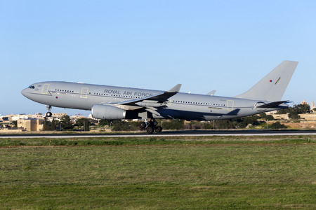 voyager: Luqa, Malta - 26 January 2016: Royal Air Force Airbus A330 Voyager KC3 (A330-243MRTT) [ZZ338] arriving runway 31, accompanying a flight of 4 Eurofighter Typhoons.