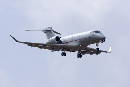 bombardier: Luqa, Malta - 28 August 2016: VistaJet Bombardier Challenger 350 (BD-100-1A10) [9H-VCA] on finals runway 31. Editorial