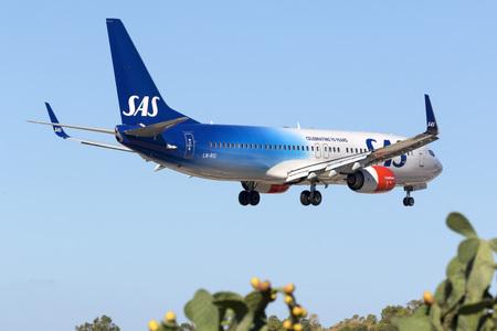 Luqa, Malta - 8 September 2016: Scandinavian Airlines - SAS Boeing 737-86N [LN-RGI] on finals runway 31. Special color scheme celebrating 70 years of SAS. Sajtókép