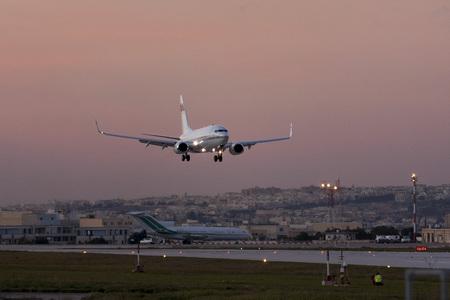Luqa, Malta - 20 November 2007: G5 Executive Boeing 737-7BC BBJ [HB-JGV] landing after sunset.